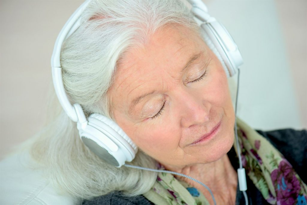 mature woman with headphones